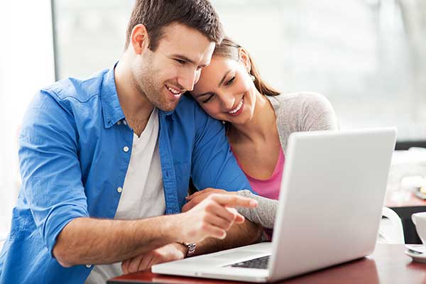 Photo of a happy couple using FSBBC online banking.